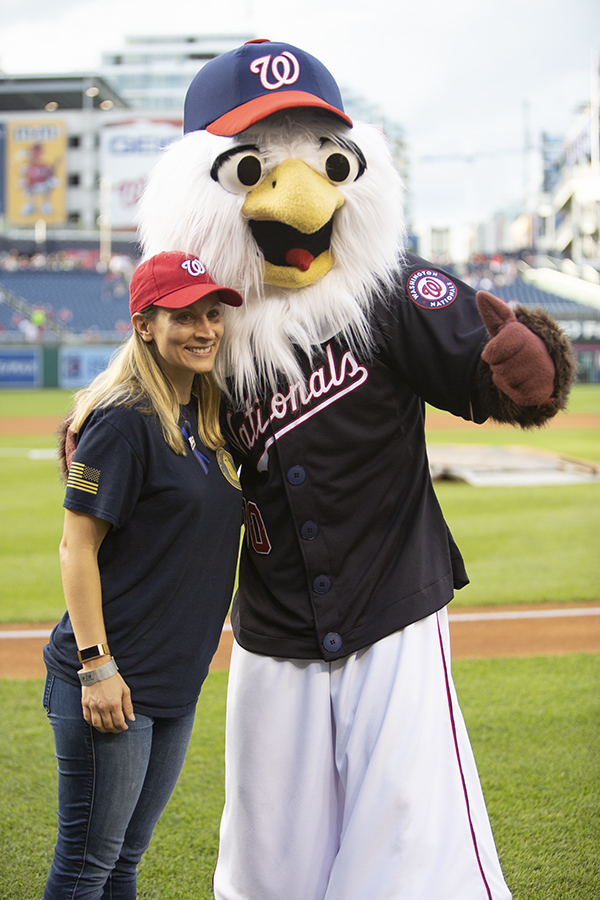 Laura Calvillo poses with Nats mascot eagle